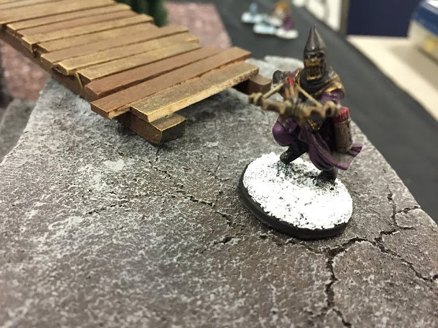 Frostgrave Cultist Crossbowman on a cliff