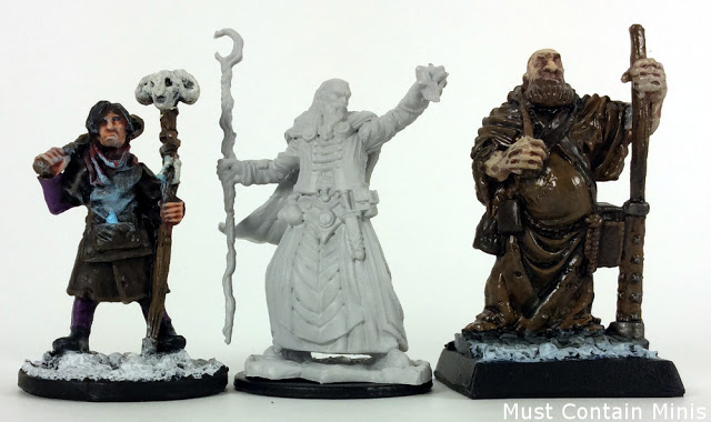 Size Comparison of North Star Military Figures Frostgave miniature to an unpainted D&D Miniature to a Reaper Miniature