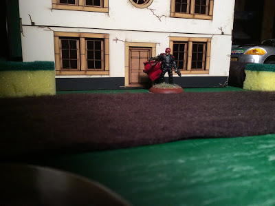 A RAFM Figure infront of a 4Ground House