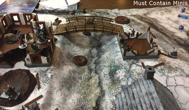 MDF Houses by XOLK on the the gaming table - Frostgrave Battle Report