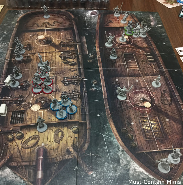 Battling between ships in a miniature board game