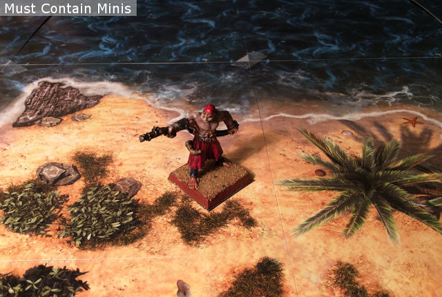 Miniature pirate on a deserted island