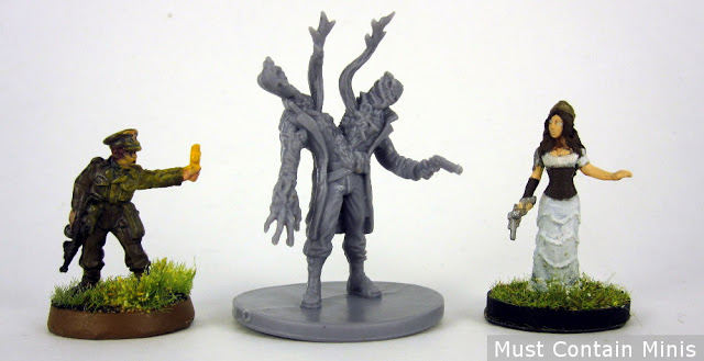 Scale Comparison of a Fireteam Zero Monster to 28 and 32mm miniatures