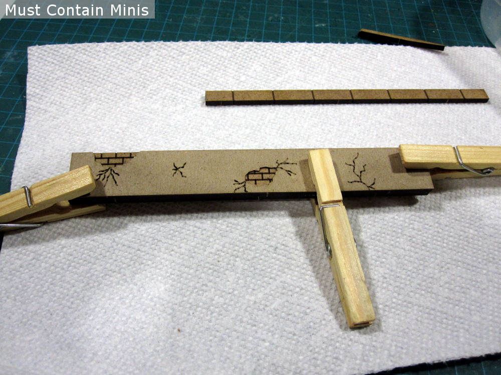 Using clothespins as clamps while building MDF Terrain