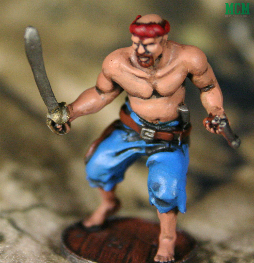 Bald Miniature armed with a blackpowder pistol and sword.