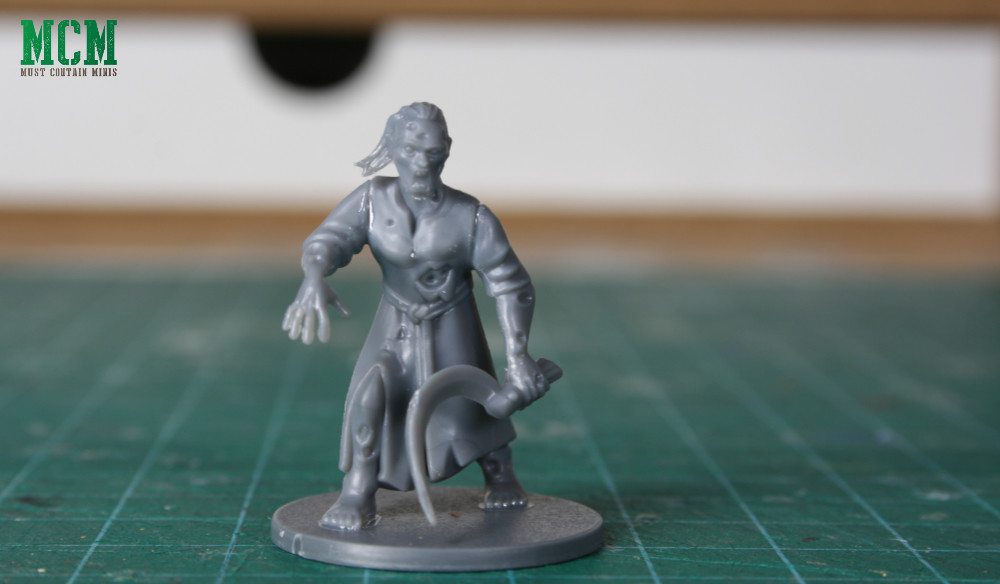 Zombie warrior miniature with a gnarly weapon