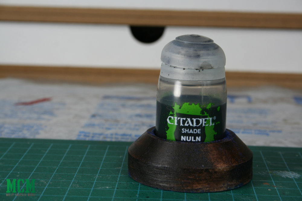 Nuln Oil paint pot holder to prevent shades from spilling on your desk