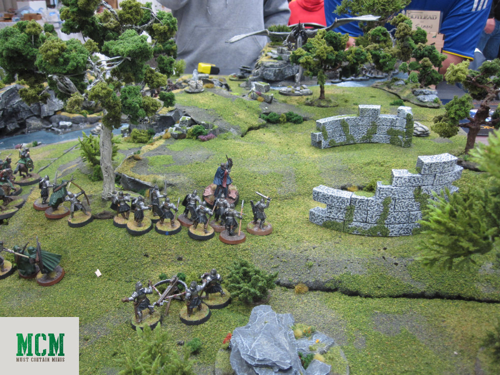 Tabletop view of the battle A Ringwraith comes down on soldiers of Gondor