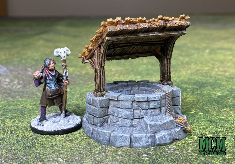 A Monster Scenery Village Well Terrain Piece with a 28mm Frostgrave Minaiture